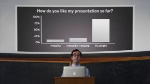 Presenter with polling slide in background
